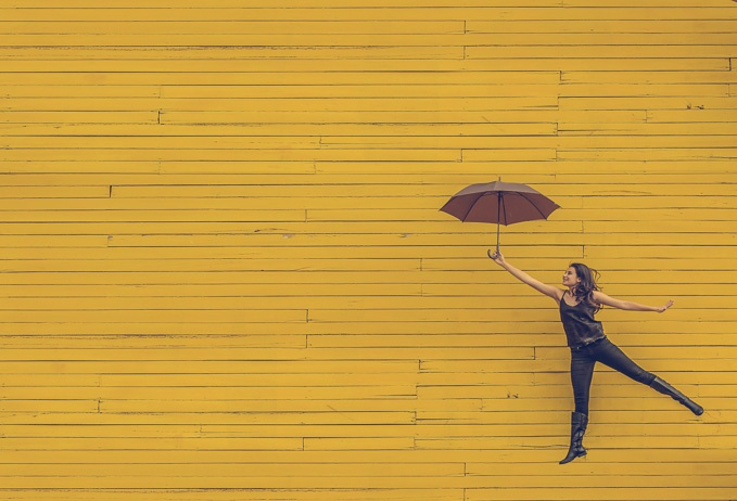 Image of girl with umbrella by Edu Lauton via Unsplash